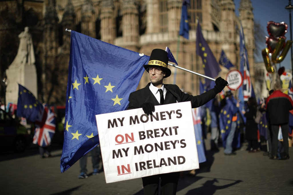 Remain in the European Union supporter Charlie Rome, aged 35 from London and dressed as British pro-Brexit politician Jacob Rees-Mogg poses for photog...
