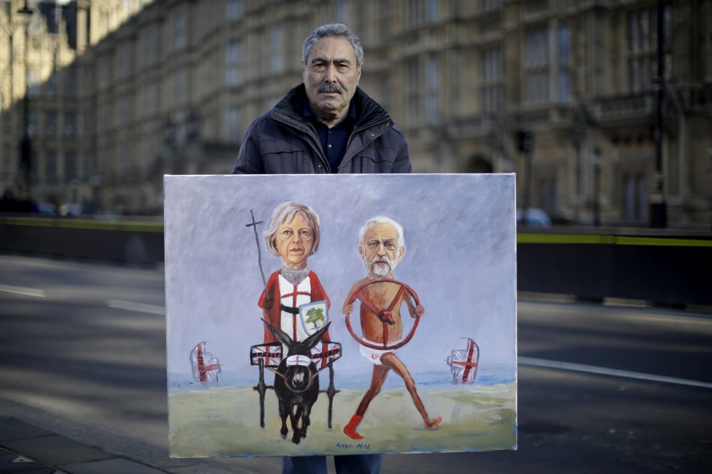 Remain in the European Union supporter Kaya Mar, aged 63 from London and originally from Spain, poses for photographs with one of his paintings that w...