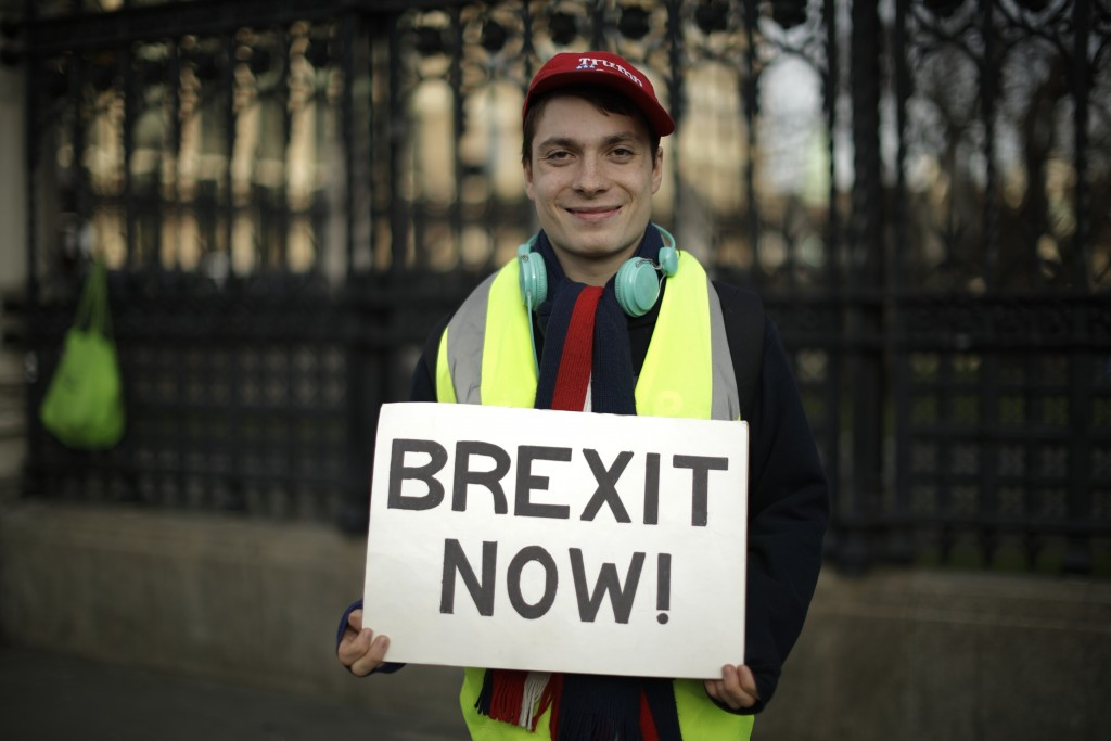 Leave the European Union supporter Max, aged 21 from London, poses for photographs outside the Houses of Parliament in London, Wednesday, Feb. 13, 201...