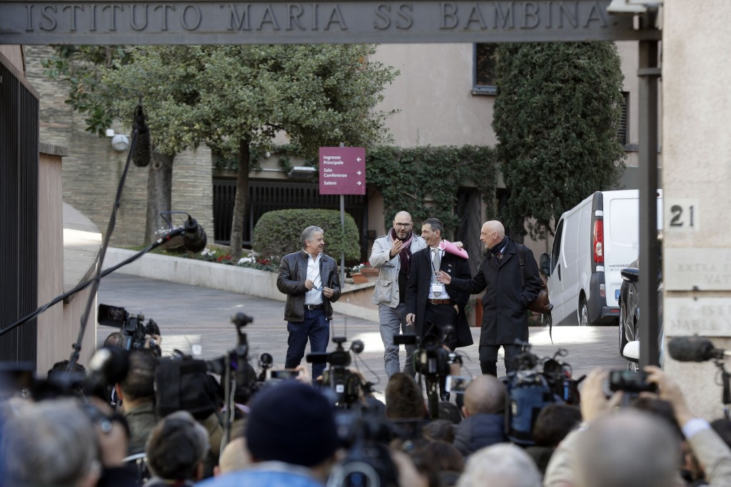 From left, sex abuse survivors Pedro Salinas, Francoise Devoiz, Pietro Zanardi and Peter Isley leave at the end of their meeting with organizers of th