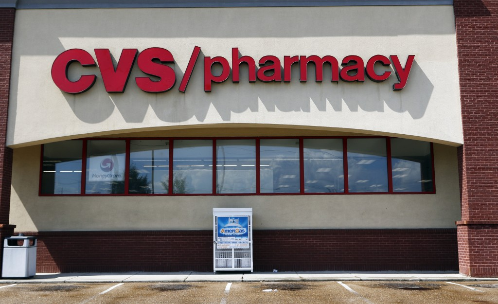 FILE- In this Aug. 7, 2018, file photo a CVS Pharmacy building sign rests on a Jackson, Miss., store. CVS Health Corp. reports financial results Wedne