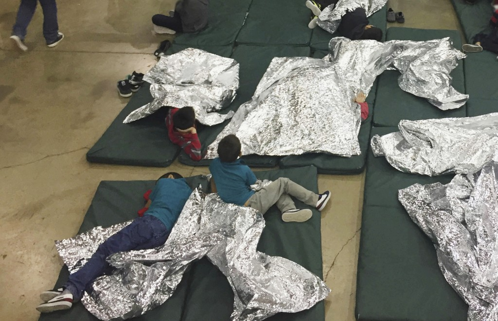 FILE - In this June 17, 2018 file photo provided by U.S. Customs and Border Protection, people who've been taken into custody related to cases of ille