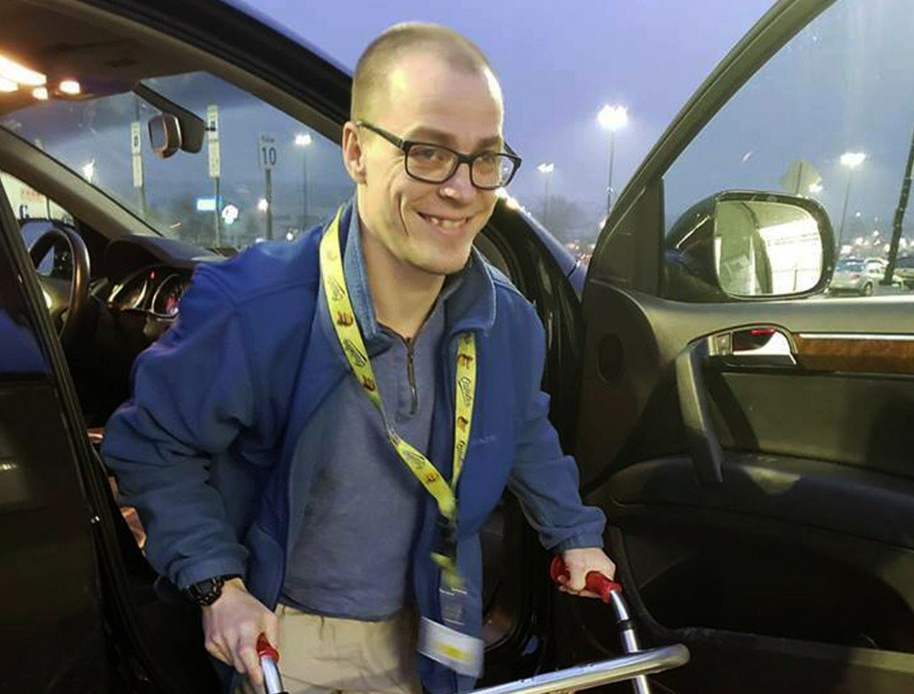 In this Dec. 14, 2018 photo provided by Holly Catlin, Adam Catlin gets out of a car before starting his shift at a Walmart in Selinsgrove, Pa. Catlin,...