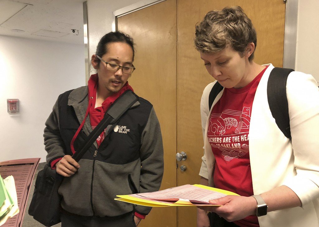 Cliff Hong, a principal at Roosevelt Middle School, left, and Amie Lamontagne, a principal at Fred T. Korematsu Discovery Academy, discuss their sched...