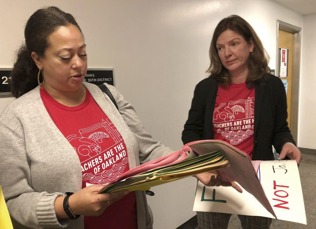 Eyana Spencer, principal at Manzanita Community School, left, and Katherine Carter, a principal at Oakland School of Language, look over their schedul...