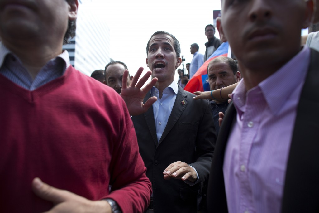 CORRECTS SPELLING OF GUAIDO - Venezuela's self-proclaimed interim president Juan Guaido walks into the crowd after he addressed transportation workers
