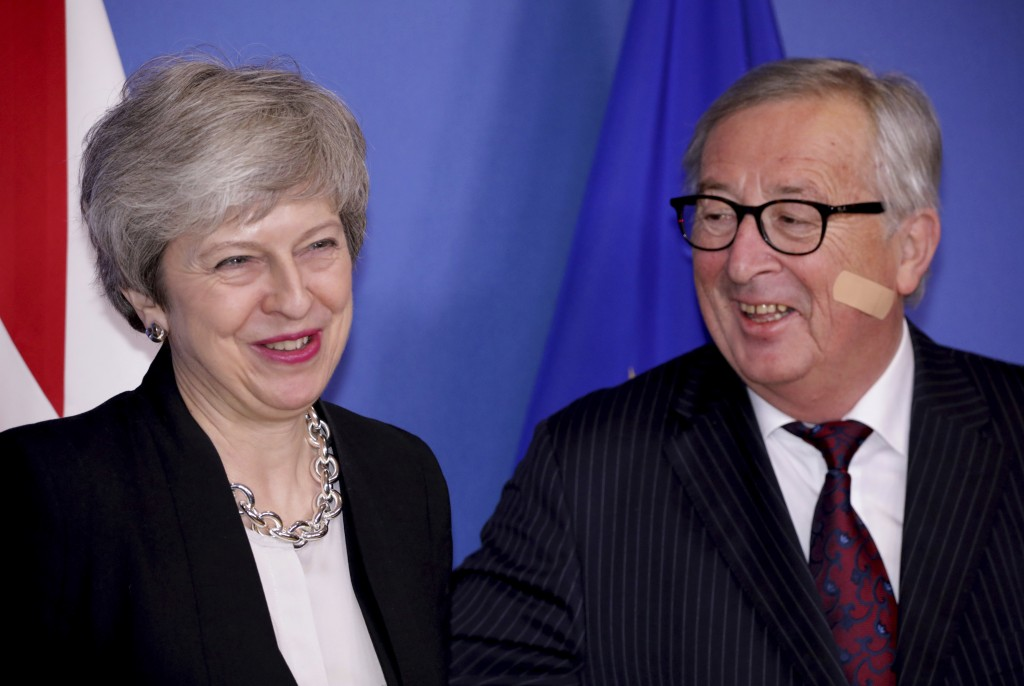 British Prime Minister Theresa May, left, is greeted by European Commission President Jean-Claude Juncker prior to a meeting at EU headquarters in Bru...