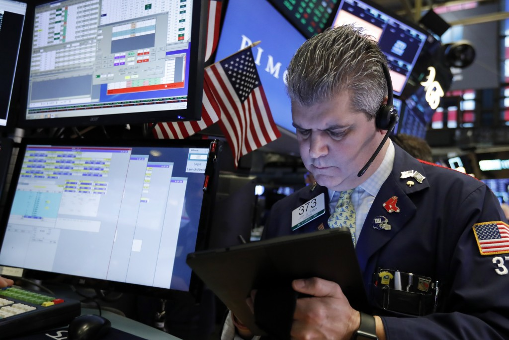 FILE- In this Feb. 15, 2019, file photo trader John Panin works on the floor of the New York Stock Exchange. The U.S. stock market opens at 9:30 a.m.