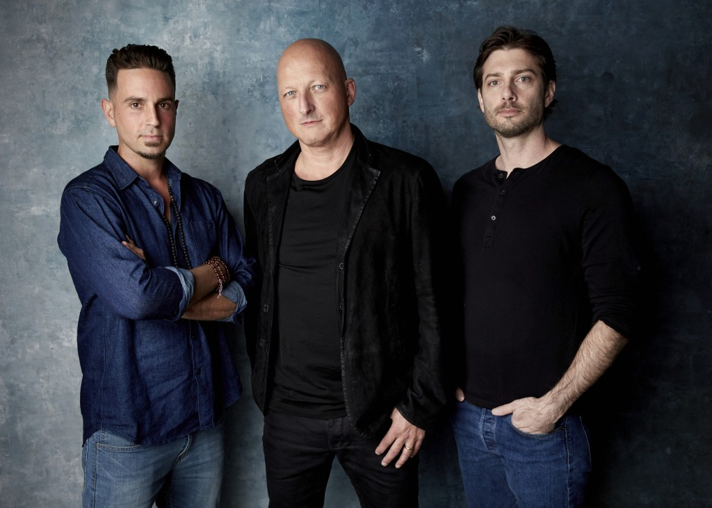 """FILE - In this Jan. 24, 2019, file photo, Wade Robson, from left, director Dan Reed and James Safechuck pose for a portrait to promote the film """"Leavi"""