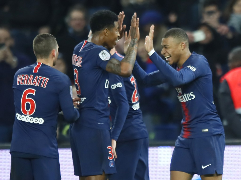 PSG's Kylian Mbappe celebrates with his teammates after scoring his side's fifth goal during the French League One soccer match between Paris Saint Ge