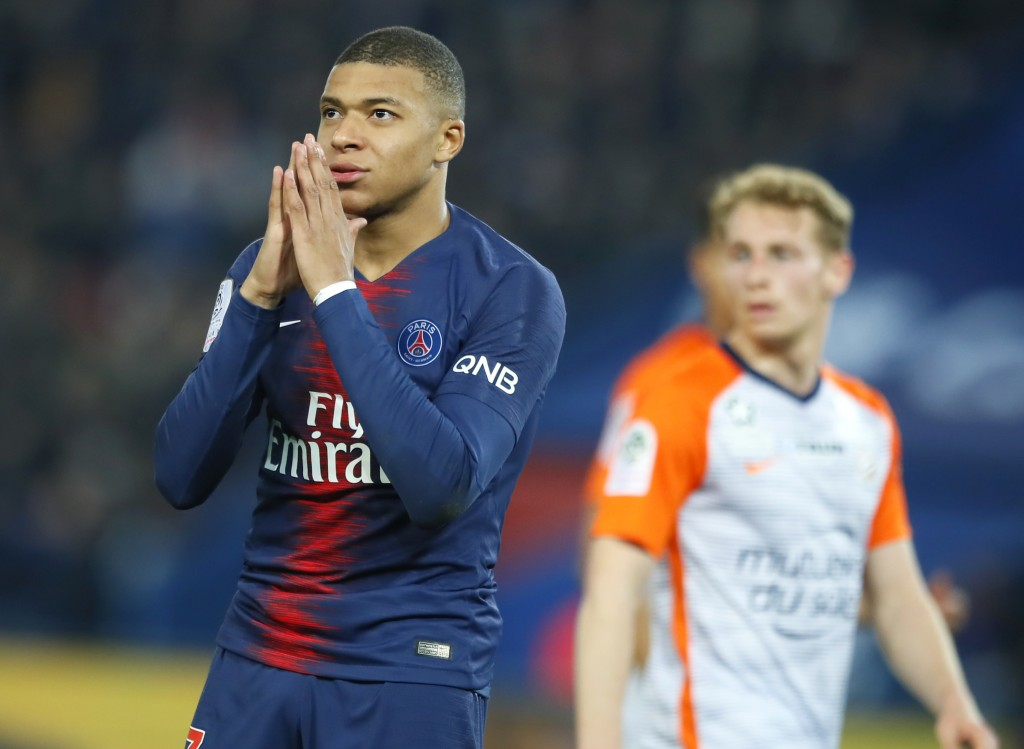 PSG's Kylian Mbappe reacts during the French League One soccer match between Paris Saint Germain and Montpellier at the Parc des Princes stadium in Pa
