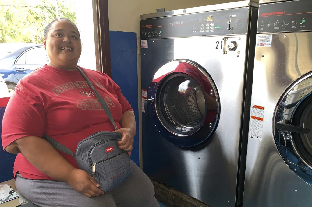 Antoninette Arriola does her laundry at a laundromat in the village of Mangilao, Guam as part of her storm preparations on Thursday, Feb. 21, 2019.  A