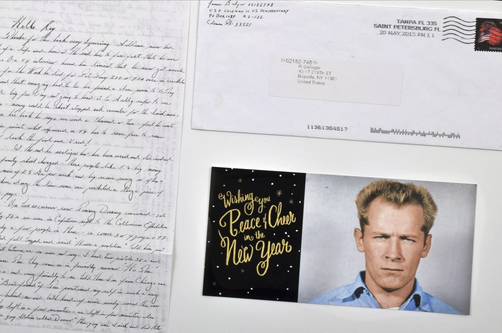"""This photo provided by Urban Culture Auctions in West Palm Beach, Fla., shows a hand-written letter by the late mobster James """"Whitey"""" Bulger, an enve"""