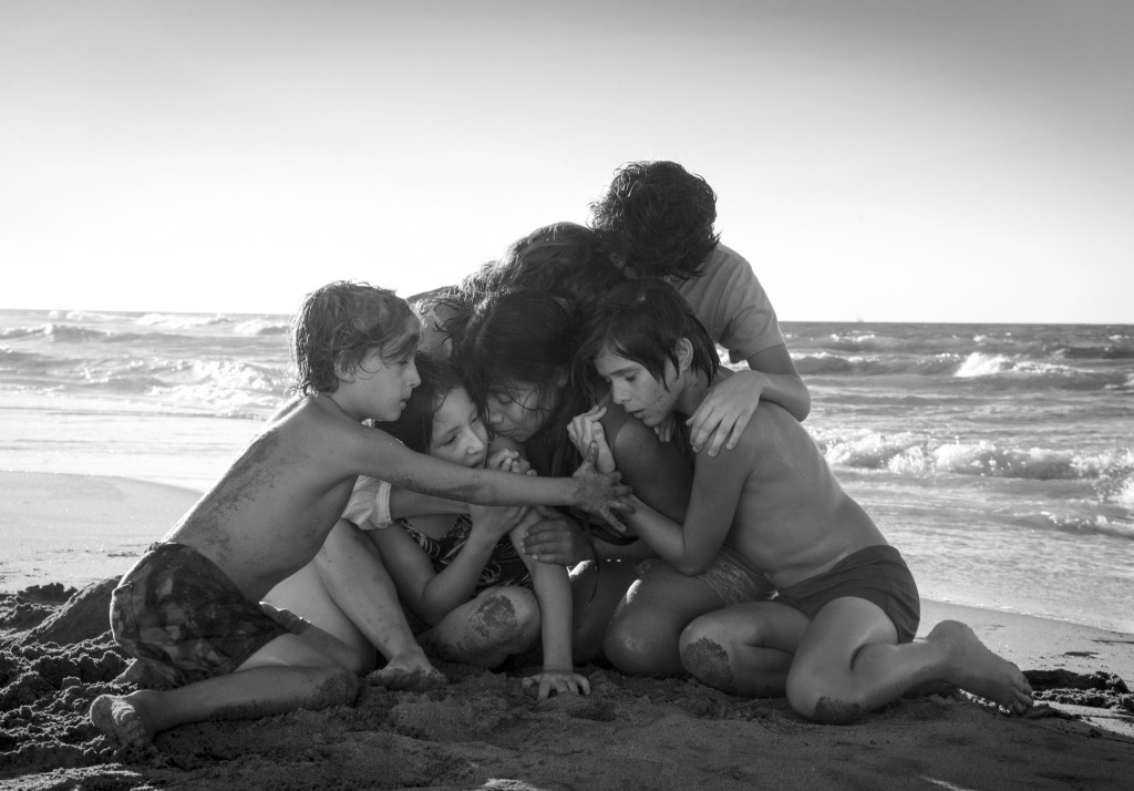 """This image released by Netflix shows Yalitza Aparicio, center, in a scene from the film """"Roma,"""" by filmmaker Alfonso Cuaron. The film is nominated for"""