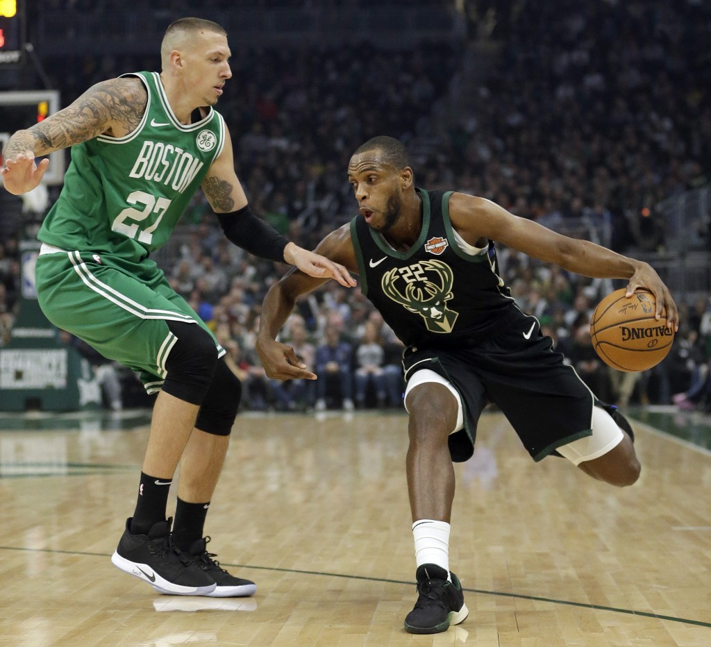 cd7bfa097 Milwaukee Bucks  Khris Middleton drives to the basket against Boston  Celtics  Daniel Theis during