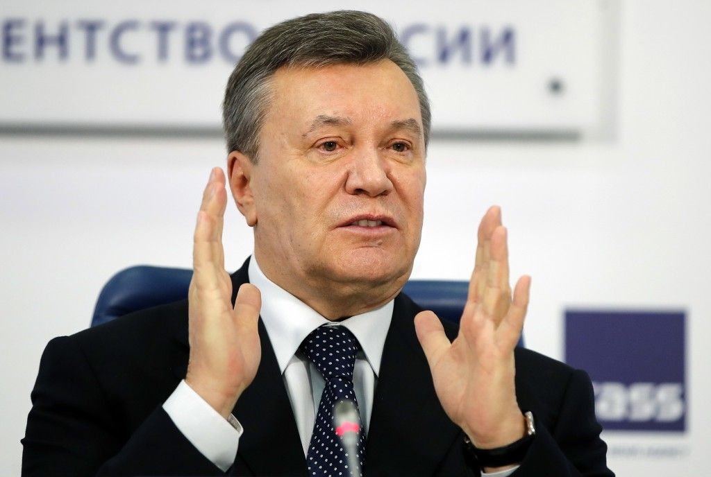 FILE - In this March 2, 2018 file photo, former Ukraine President Viktor Yanukovych gestures as he speaks at a news conference in Moscow. (AP Photo/Pa