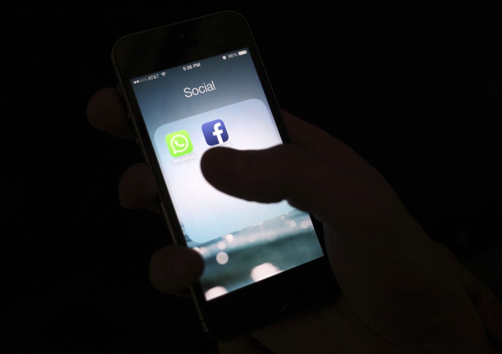 FILE - This Feb. 19, 2014, file photo shows the Facebook app icon on an iPhone in New York. The Wall Street Journal is reporting that several phone ap