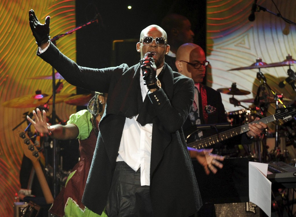 FILE - In this Jan. 25, 2014 file photo, recording artist R. Kelly performs at The 56th Annual Grammy Awards Salute to Industry Icons with Clive Davis...