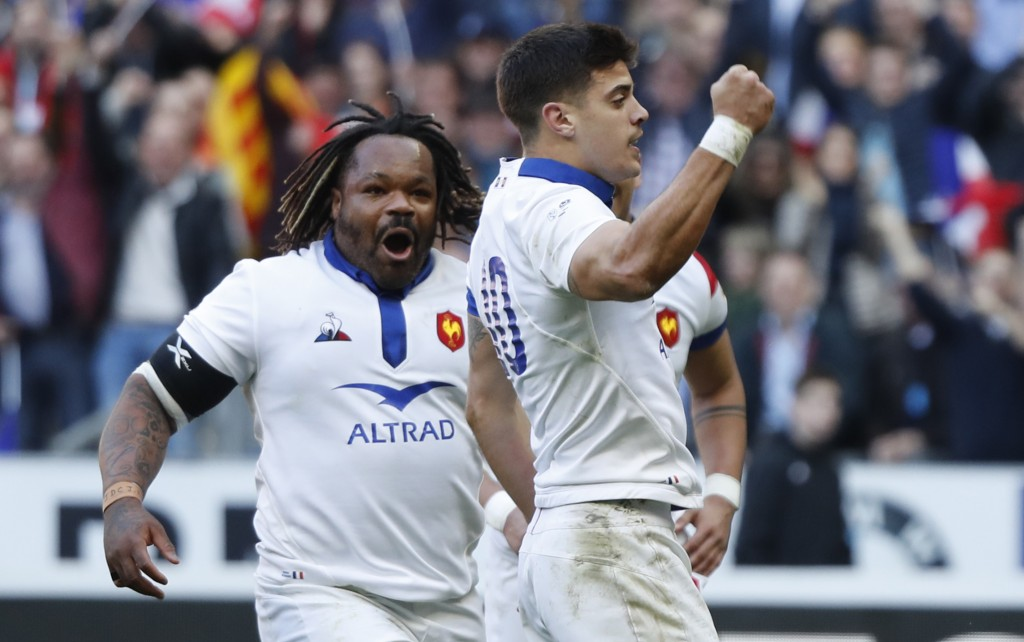Mathieu Bastareaud of France, left, goes to celebrate with Romain Ntamack of France who scored the opening try of the game during the Six Nations rugb...