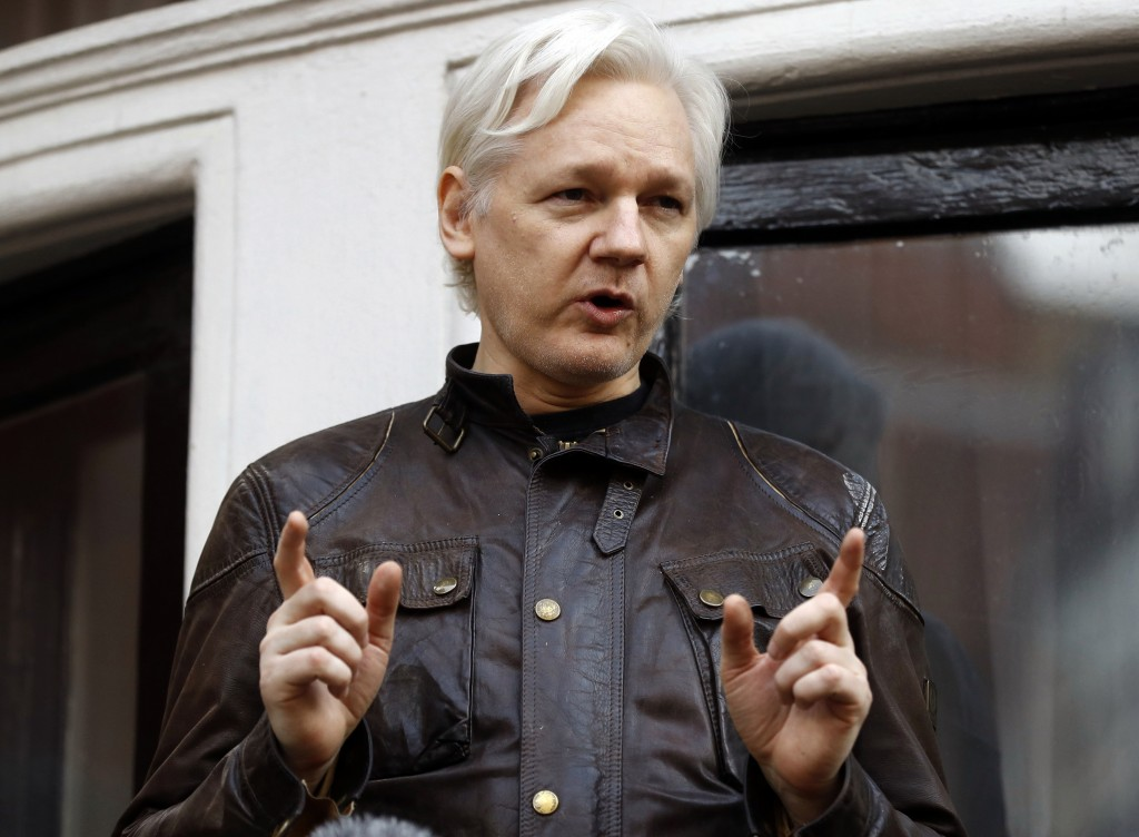 FILE - In this May 19, 2017 file photo, WikiLeaks founder Julian Assange gestures to supporters outside the Ecuadorian embassy in London, where he has