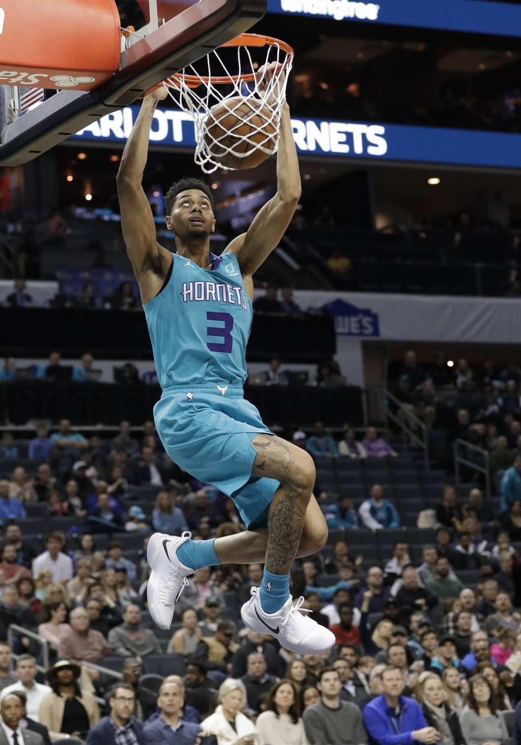 Charlotte Hornets guard Jeremy Lamb (3) dunks against the Washington Wizards during the first half of an NBA basketball game in Charlotte, N.C., Frida...