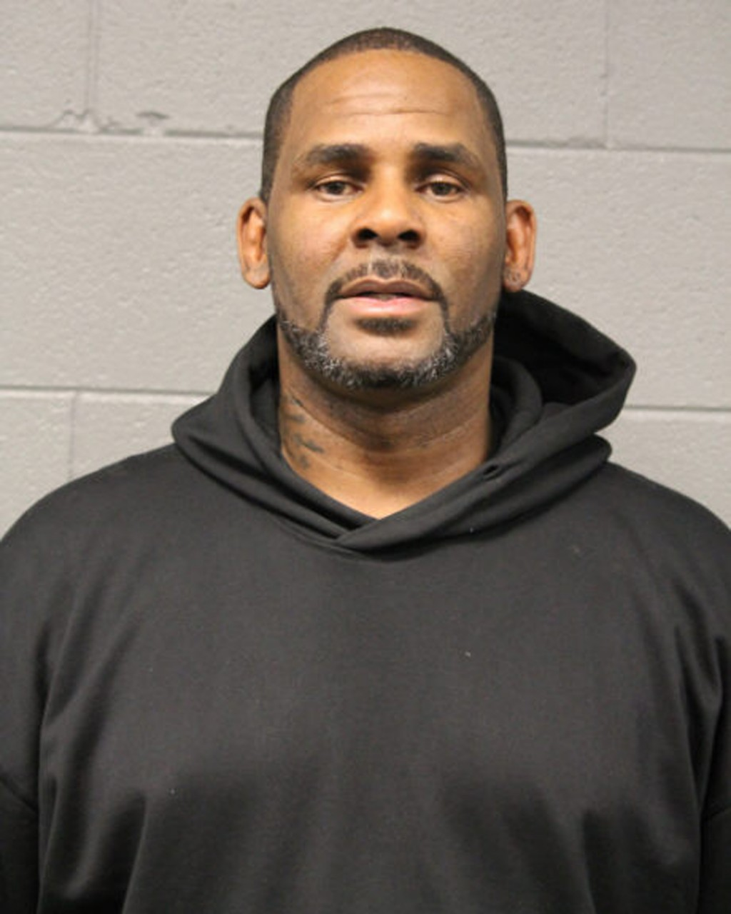 In this photo taken and released by the Chicago Police Dept., Friday, Feb. 22, 2019, R&B singer R. Kelly is photographed during booking at a police st