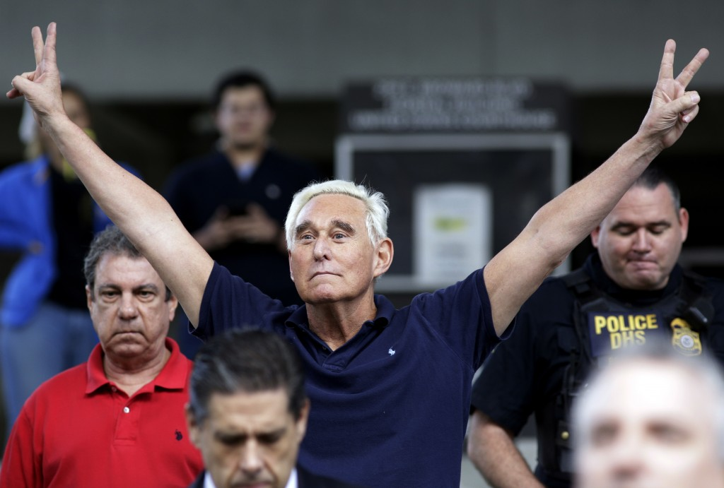 FILE - In this Jan. 25, 2019, file photo, former campaign adviser for President Donald Trump, Roger Stone walks out of the federal courthouse followin