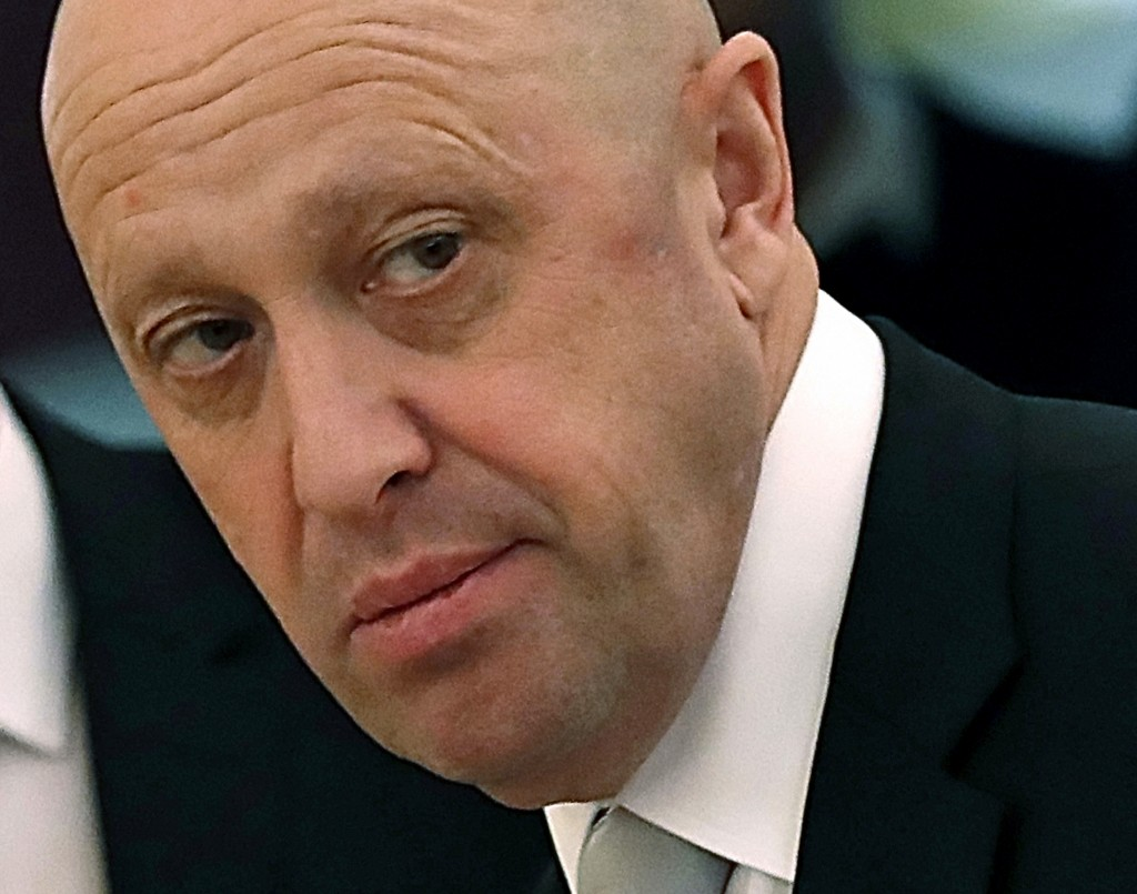 FILE - In this July 4, 2017 file photo, Russian businessman Yevgeny Prigozhin is shown prior to a meeting of Russian President Vladimir Putin and Chin