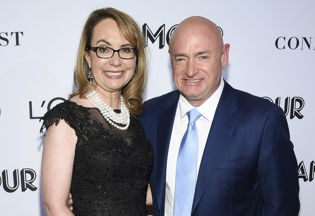 FILE- In this Nov. 12, 2018, file photo politician and gun control advocate Gabrielle Giffords and husband, retired astronaut Mark Kelly, attend the G...
