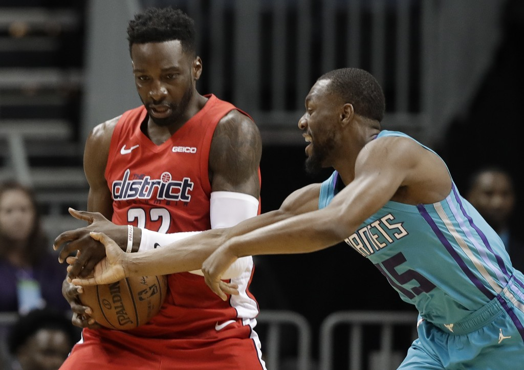 Charlotte Hornets guard Kemba Walker (15) tries to steal the ball from Washington Wizards forward Jeff Green (32) during the first half of an NBA bask...