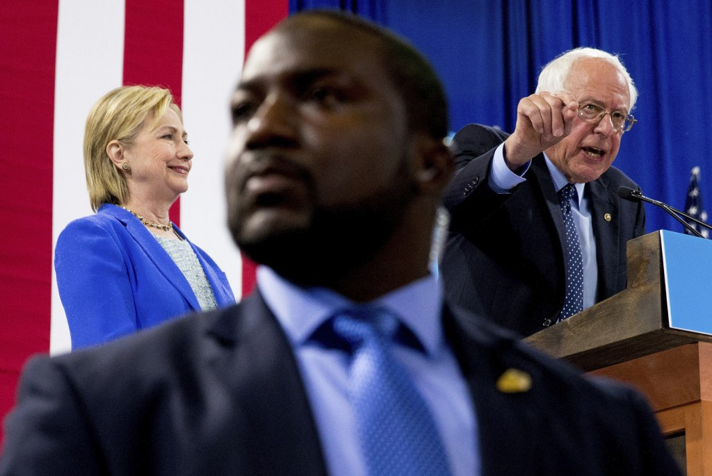 FILE - In this July 12, 2016, file photo, a member of the Secret Service stands guard as Sen. Bernie Sanders, I-Vt., accompanied by Democratic preside