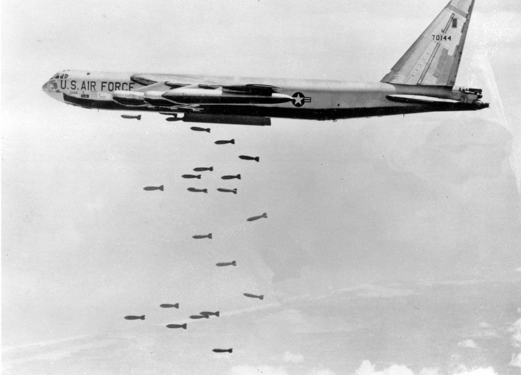 FILE - In this March 1966, file photo, a U.S. Air Force B-52 delivers a bomb load of more than 38,000 pounds against Viet Cong strongholds in South Vi