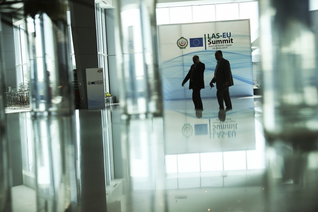 Security guards walk along the main hall of the Sharm El Sheikh convention centre in Sharm El Sheikh, Egypt, Saturday, Feb. 23, 2019. Leaders from the