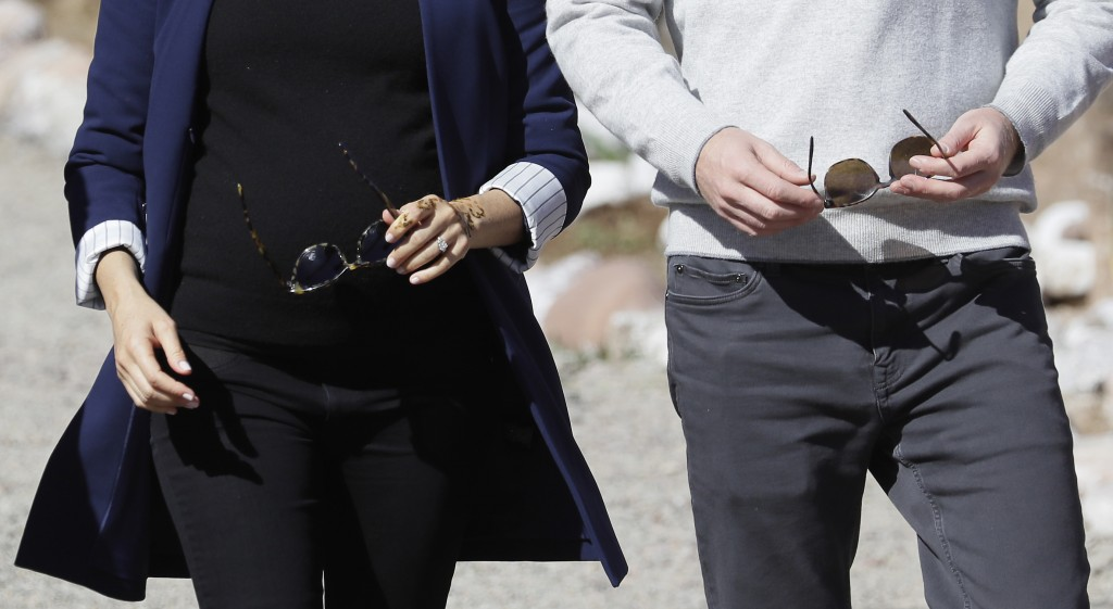 Britain's Prince Harry and Meghan, Duchess of Sussex, with her hand displaying a henna tattoo during a visit to an 'Education for All' boarding house