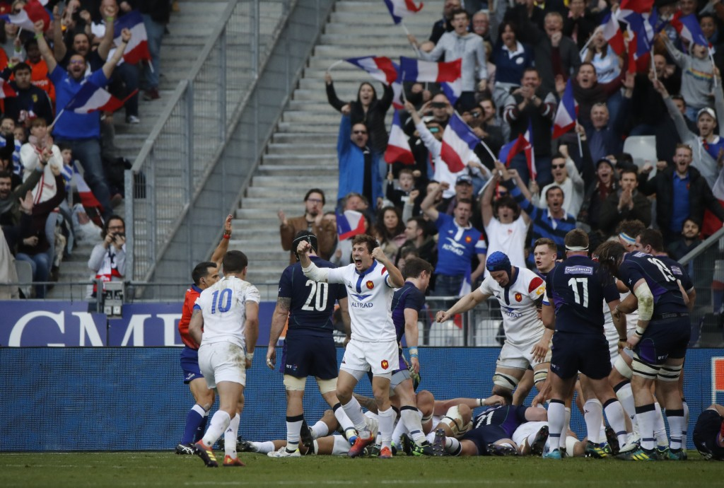 The French team celebrate as Gregory Alldritt of France scores a try during the Six Nations rugby union international match between France and Scotlan...