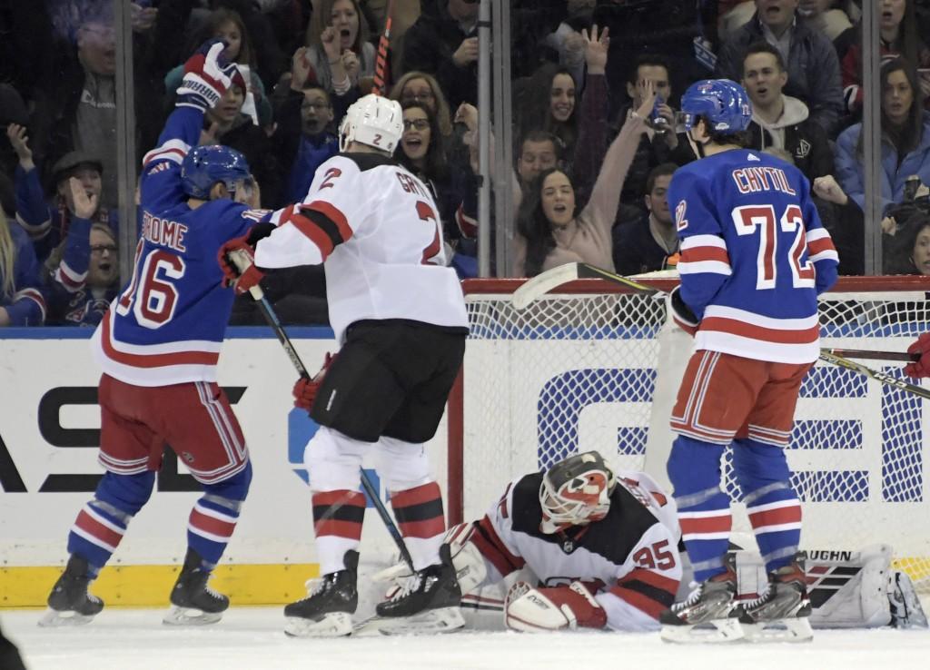 New York Rangers center Ryan Strome (16) celebrates his goal against New Jersey Devils goaltender Cory Schneider (35) as Devils defenseman Eric Gryba