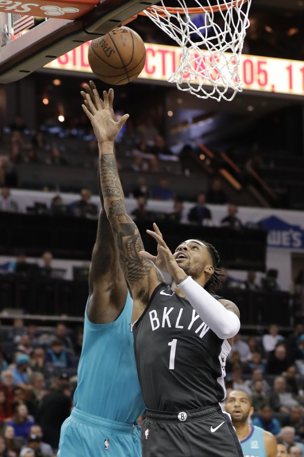 Brooklyn Nets' D'Angelo Russell (1) drives past Charlotte Hornets' Marvin Williams during the first half of an NBA basketball game in Charlotte, N.C.,