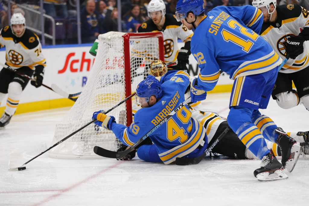 St. Louis Blues' Ivan Barbashev (49), of Russia, attempts to pass the puck after a shot on goal against the Boston Bruins during the second period of ...