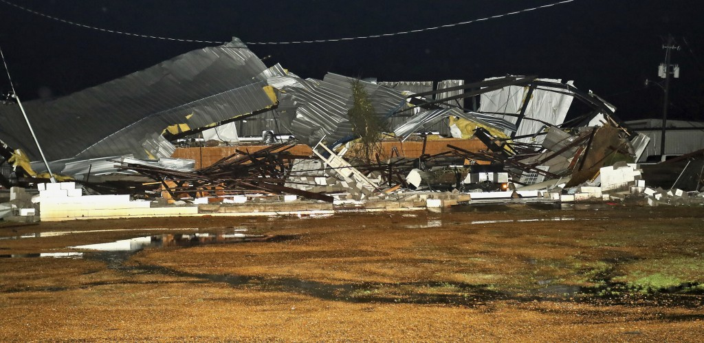 A destroyed business along Conway Drive in Columbus, Miss., sits in ruins after an apparent tornado struck the area on Saturday, Feb. 23, 2019. (AP Ph...
