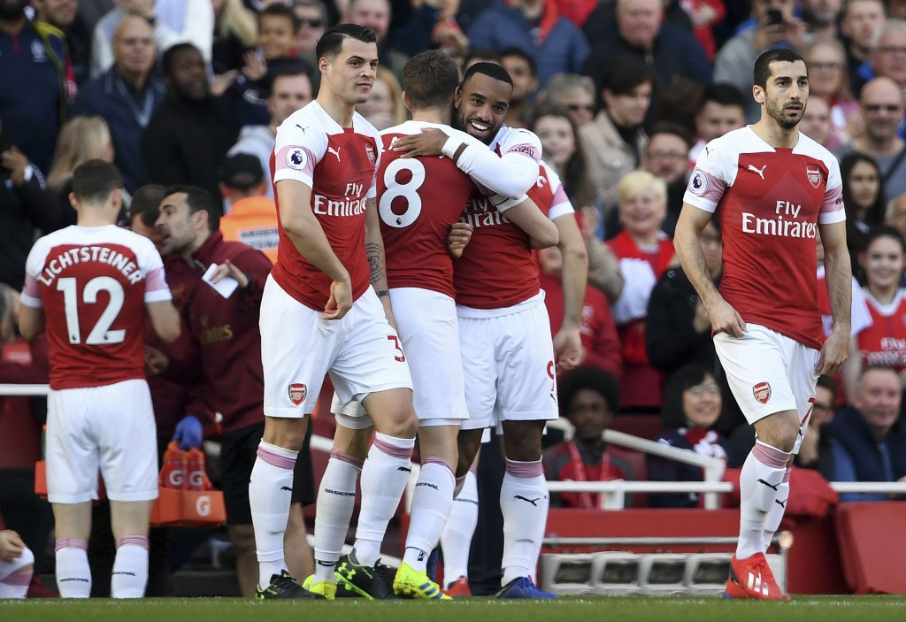 Arsenal's Alexandre Lacazette, centre right, celebrates scoring his side's first goal of the game against Southampton, during their English Premier Le...
