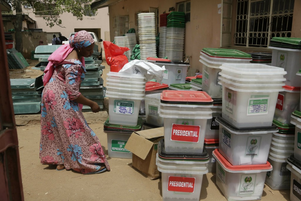 An electoral worker checks ballot boxes at the electoral commission office in Yola, Nigeria, Sunday, Feb. 24, 2019. Vote counting continued Sunday as