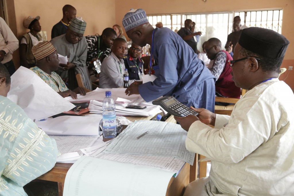 Electoral officials compile voting results at a collation center in Yola, n Nigeria, Sunday, Feb. 24, 2019. Vote counting continued Sunday as Nigerian