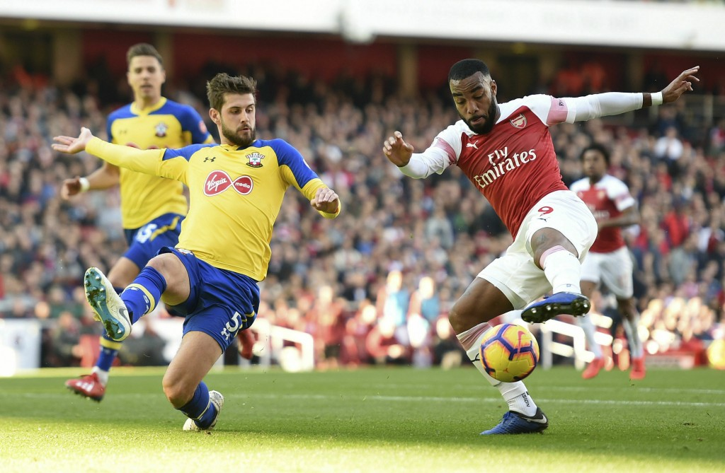 Southampton's Jack Stephens, left, and Arsenal's Alexandre Lacazette in action during their English Premier League soccer match at the Emirates Stadiu