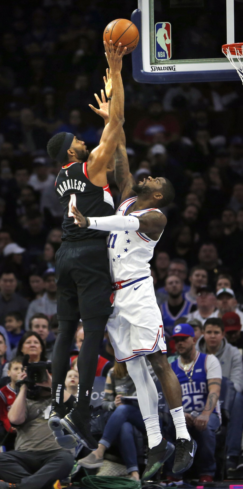 Portland Trail Blazers forward Maurice Harkless (4) takes a shot over Philadelphia 76ers forward James Ennis III (11) during the first half on an NBA