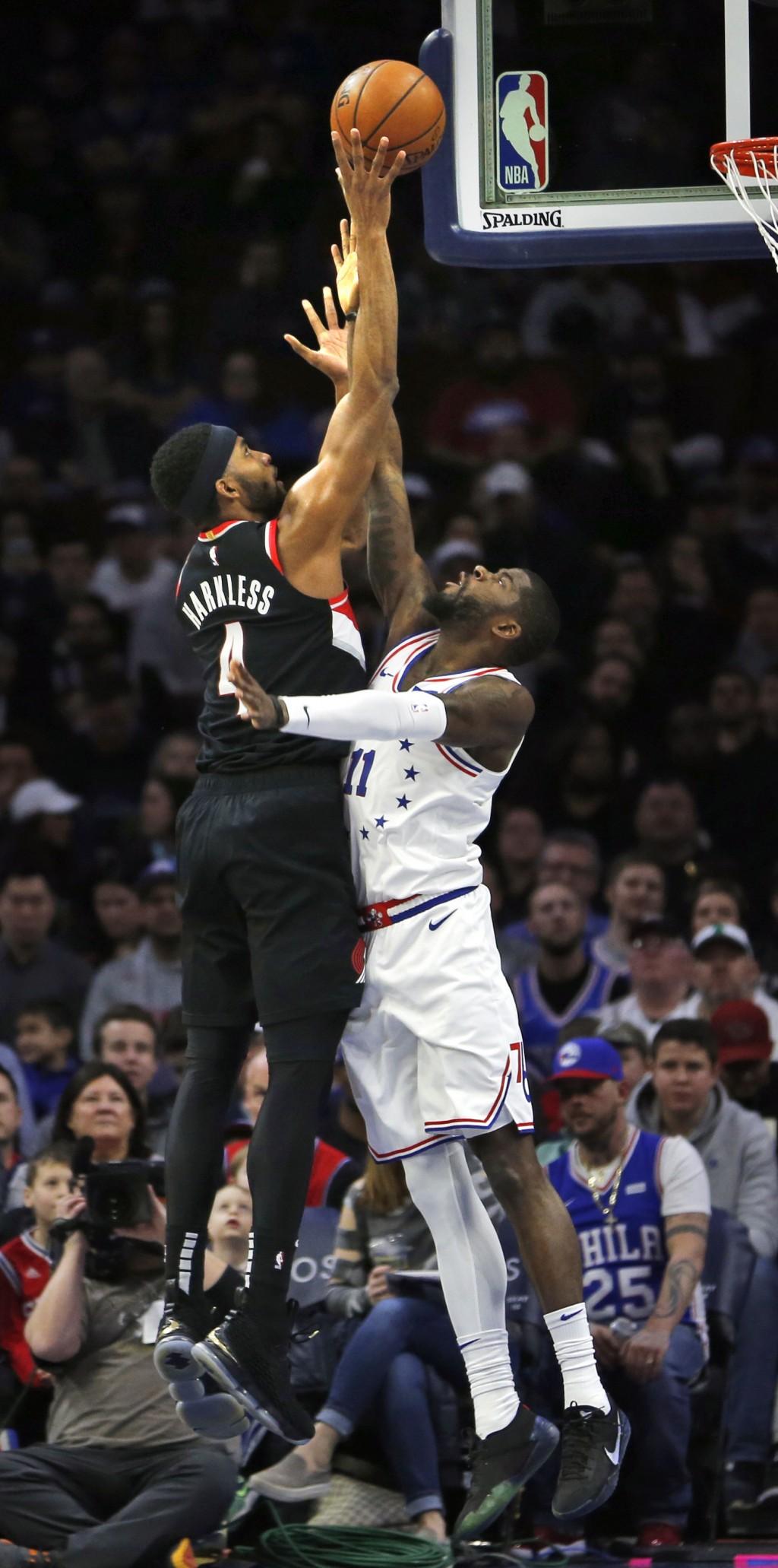 Portland Trail Blazers forward Maurice Harkless (4) takes a shot over Philadelphia 76ers forward James Ennis III (11) during the first half on an NBA ...