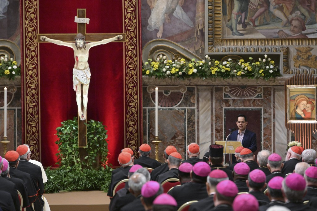 A survivor of sex abuse, who wished to remain anonymous, background right, delivers his testimony during a penitential liturgy attended by Pope Franci...