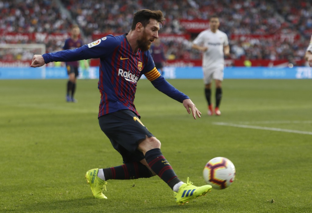 Barcelona forward Lionel Messi kicks the ball during La Liga soccer match between Sevilla and Barcelona at the Ramon Sanchez Pizjuan stadium in Sevill...