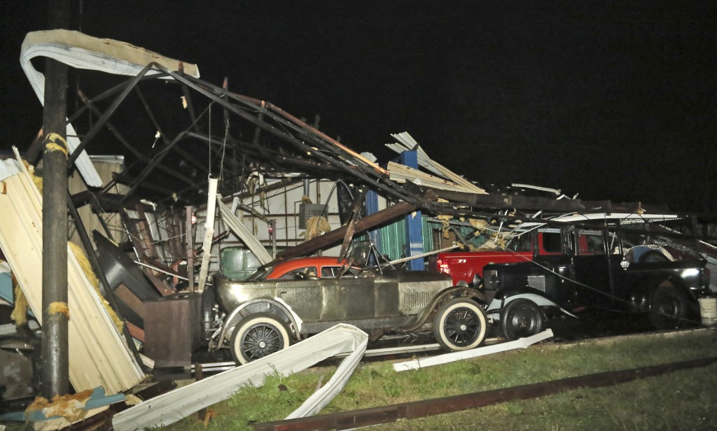 This photo shows damage at Lawrence Motors in Columbus, Miss., Saturday, Feb. 23, 2019, after a tornado hit in the city's downtown area. Witnesses say...
