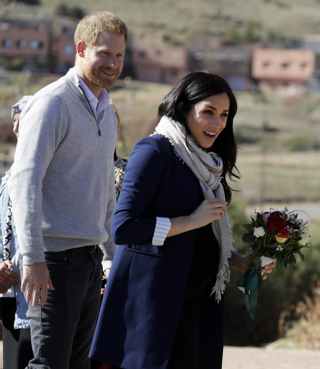 Britain's Prince Harry and Meghan, Duchess of Sussex arrive for a visit to an 'Education for All' boarding house in Asni Town in Morocco, Sunday, Feb.