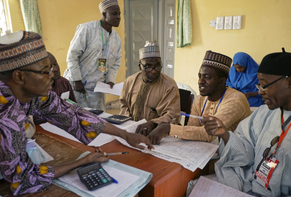 Electoral officials compile voting results at a collation center in Kano, northern Nigeria Sunday, Feb. 24, 2019. Vote counting continued Sunday as Ni